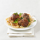 Spaghetti and meatballs with copyspace composition. — Stock Photo