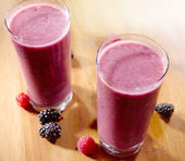 Berry smoothie in a tall glass — Stock Photo