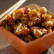 General tso's chicken in a bowl. — Stok fotoğraf