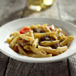 Gorgonzola cheese in pasta with beef and red bell peppers — Stock Photo #8630415