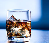 Highball glass of alcohol with ice — Stock Photo