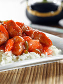 Sweet and sour pork on rice — Stock Photo