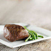 Steak with green beans and copyspace — Stock Photo