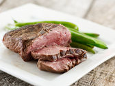 Sliced up rare steak — Stock Photo