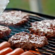 Grilling burgers and hot dogs — Stock Photo