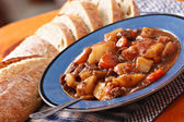 Beef stew with bread loaf — Stock Photo