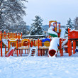 Equipement in children play park under snow — Stock Photo