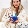 The girl with long hair in a plaid with the big dark blue cup — Stock Photo