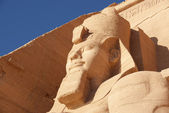 Close-up the colossal statue of Ramesses II in Abu Simbel temple — Stock Photo