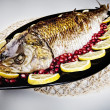Fried fish in the plate — Stock Photo