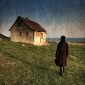 The little old house by the sea — Stockfoto