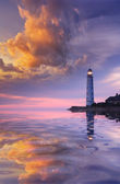 Beautiful seascape with a lighthouse at sunset — Stock Photo