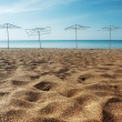 Parasols on the sandy beach — Stock Photo