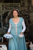 Medieval woman with dishes — Stock Photo