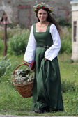 Medieval woman with busket — Stock Photo