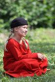 Medieval girl in red — Stock Photo