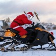 Santa Claus on snowmobile — Stock Photo