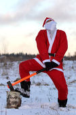 Santa Claus with axe — Stock Photo