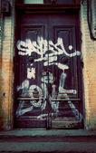 Graffiti on the door — Stock Photo