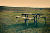 Picnic table on the river. Vintage look — Stock Photo