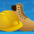 Hard hat and work boots with blue print background — Stock Photo
