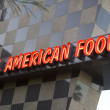 Neon food sign in Palm Springs - Stock Photo