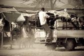 Men catch a ride uphill in Kenya — Stock Photo