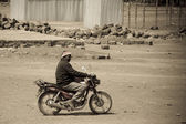 Man on a motorcycle in Kenya — Stock Photo