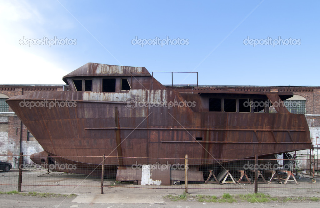Unfinished old ship at the shipyard in Gdansk.  Stock Photo #8189240