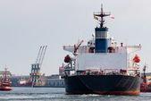 Big ship and tugboat assist. — Stock Photo