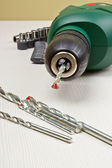 Green electric drill — Stockfoto