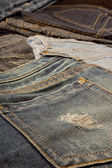 Ripped blue jeans pocket detail — Stock Photo