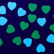 Stock Photo: Blue and green hearts on dark blue background