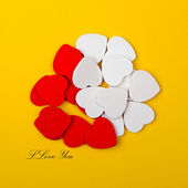 White and red hearts on yellow background — Stock Photo