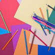Stock Photo: Background of differently colored papers and pencils