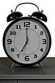 Black alarm clock: seven o'clock — Stock Photo