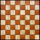 Old wooden chessboard — Stock Photo