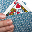 Four cards in hand — Stock Photo