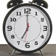 Black alarm clock: seven o'clock — Stock Photo