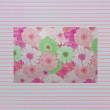 Shabby textile Background with colorful pink and white stripes and flowers — Stock Photo