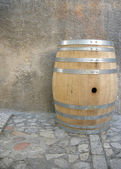 Wine barrel on cobblestone. — Stock Photo