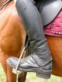 Person wearing riding boots — Stock Photo