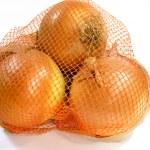 Onions in net — Stock Photo #9236566
