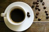 Xícara de café na mesa rústica — Foto Stock