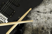 Electric guitar and drumsticks — Stock Photo