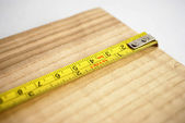 Measuring a plank — Stock Photo