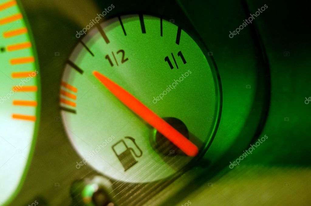 Fuel gauge on car dashboard — Stock Photo #9221246