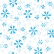 Seamless pattern of snowflakes — Stock Vector