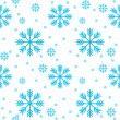 Stock Vector: Seamless background of snowflakes