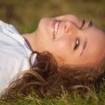 Relaxing girl on meadow — Stock Photo